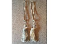 Two heavy weight curtain tie backs.