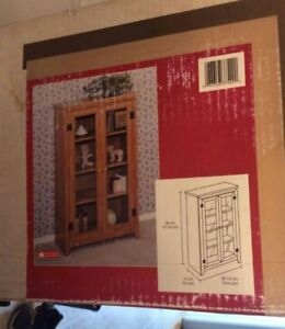 BRAND NEW IN BOX......GLASS DOOR STORAGE CABINET