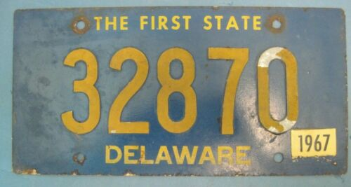 old 1967 Delaware license plate with riveted numbers
