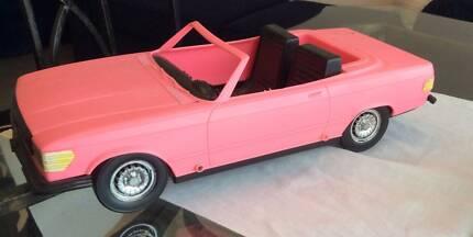 Antique pink barbie car