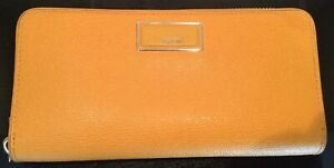 TUMI Brand yellow ladies Leather Wallet - like new tags removed