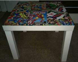 Marvel themed hand decorated table on white table