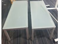 3 Blue hued glass office tables