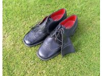 Pair Men's black leather traditional golf shoes with spikes