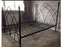 Double black wrought iron bed frame