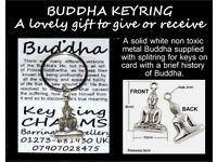 BUDDHA KEYRING ON CARD WITH BRIEF HISTORY