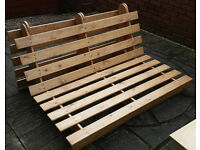 pine wood futon frame, 153cm wide. In very good condition.