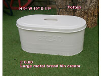large cream metal bread bin