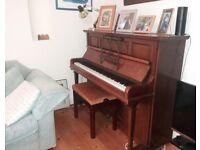 Beautiful mahogany Rogers upright piano and piano stool