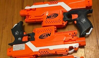 Lot of 2 Nerf STRYFE Orange Black working great with 2 Drum ammo clips