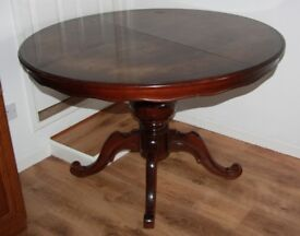 Round extendable dark wood dining table