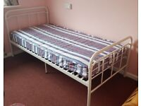Single bed frame and mattress.
