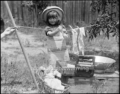 Girl Clothes Online (Photo. 1905. Australia. Cute Girl Playing House - Drying Clothes on)