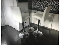 Bar stools and glass chrome table