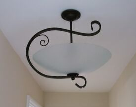 Large swirly black metal and glass pendant lamp. Art deco style