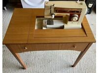 Vintage Singer 6106 sewing machine and desk