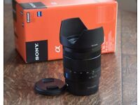 Sony E 16-70mm f4 ZA OSS Vario-Tessar lens with image stabilisation. AS NEW!