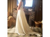 Wedding dress size 12 worn and been in storage dry clean only lovely train