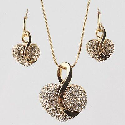 Schmuck Set - Ohrringe, Anhänger und Kette. Goldene Herz mit Strass. Halskette