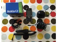 Nokia c2 silver with in car charger, head phones original box and x2 mains chargers. Good condition
