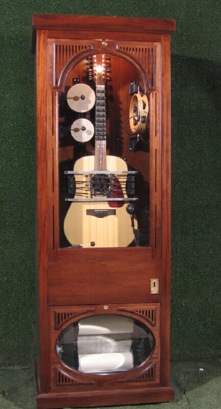 automated 12 String guitar in cabinet jukebox  Roll operated