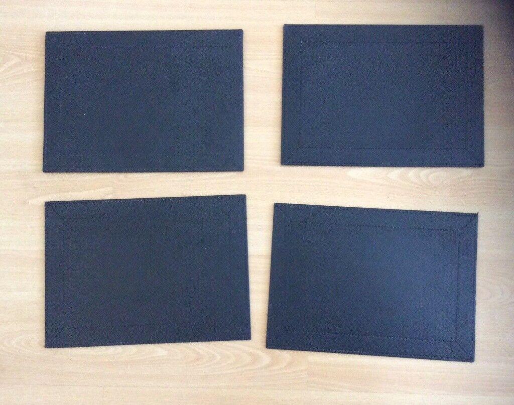 Set of 4 black stitch faux leather plate mats
