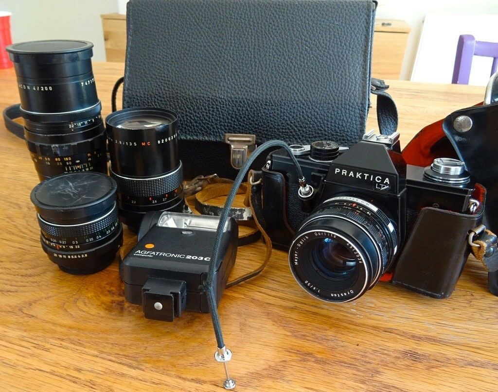 Rare praktica camera and pentacon zooms with many accessories