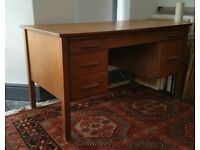 Solid oak desk with integrated drawers.