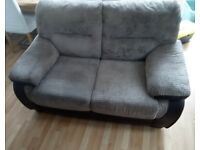 Brown leather and fabric two seater sofa