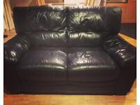 Leather sofa and matching armchair