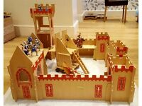 ELC wooden castle with 9 play figures. Slots together for easy storage.