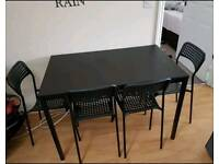 Ikea table with 4 chairs (black)