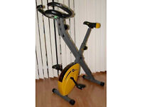 Golds Gym Exercise Bike. Rarely Used. Great Condition. Extra soft seat cover.