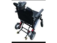 Looking for an electric powered wheelchair with steering controls from the carer's side (handles)