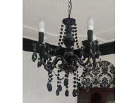 Beautiful black droplet chandelier. Ceiling light.
