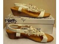 white wedge strap flower sandals