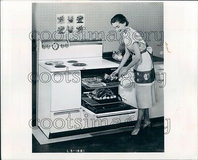 Cooking With Electric Stove - 1954 1950s Woman Cooking With Vintage General Electric Stove Press Photo