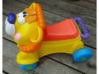 FISHER PRICE WALK AND RIDE MUSICAL LION WALKER RIDE-ON