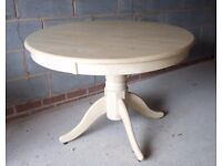 Massive round wooden table
