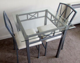 Glass dining table + 2 chairs
