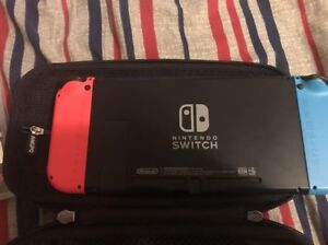 64 GB nintendo switch with case and 3 games 10/10 condition