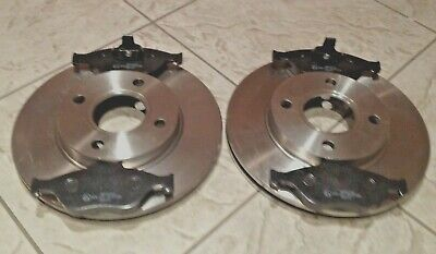 FORD FIESTA MK 6  02-08 TWO FRONT VENTED BRAKE DISCS AND A SET OF BRAKE PADS L&R