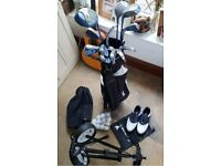 Ladies Dunlop Graphite shafted golf clubs. With bag, trolley and size 5 shoes and bag.