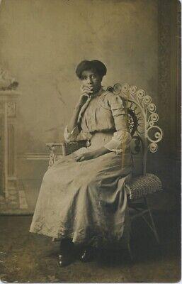 REAL PHOTO POSTCARD. SEDATE AFRICAN-AMERICAN WOMAN.