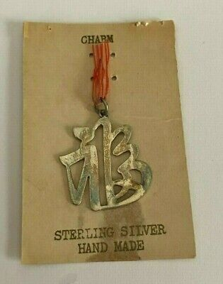**50 Year Old Vintage Sterling Silver Charm Symbol from -