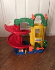 Little Tikes kids play garage with ramp and lift.