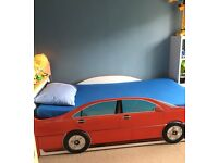 CAR BED WITH 7ft STORAGE COMPARTMENT UNDERNEATH THE BED MATTRESS IS INCLUDED AS FREE OF CHARGE.