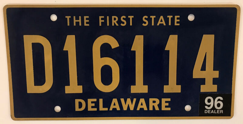 DE 1996 RIVETED CAR DEALER license plate Ford GMC Chevrolet Cadillac Pontiac AMC