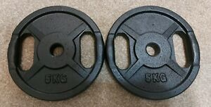 2 x 5kgs cast iron standard weight plates
