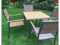 Polly Wood, Garden Table And Four Chairs. Unused